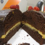 Cross-Section of Two-Layer Chocolate Cake with Cream Cheese Filling